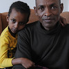 Beverly:<br /> Dawit Dabulo and his daughter, Mikol Neka, 6, and Ganad Neka, 11, not in the photo, arrived in Beverly in January as refugees from Kenya. They are being helped by the Refugee Immigration Ministry, which is holding its 8th annual Spring into Auction on Saturday, April 9, in Topsfield.<br /> Photo by Ken Yuszkus/Salem News, Wednesday, April 6, 2011.