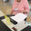 Hamilton:<br /> Lillian Allen places her ballot into the ballot box at Winthrop Elementary School during the town election.<br /> Photo by Ken Yuszkus/Salem News, Thursday, May 24, 2012.