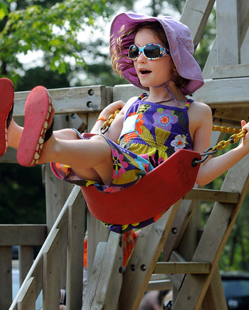 Beverly:<br /> Sienna Cullem, 5 1/2, has fun swinging at the kindergarten playground during the summertime story hour at the Cape Ann Waldorf School on Tuesday morning.<br /> Photo by Ken Yuszkus/Salem News, Tuesday, July 12, 2011.