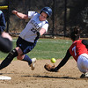 Beverly:<br /> Endicott College's Nicole Devlin rounds second base past Eastern Nazarene College's Bethany Greenfield.<br /> Photo by Ken Yuszkus/Salem News, Friday, April 2, 2010.
