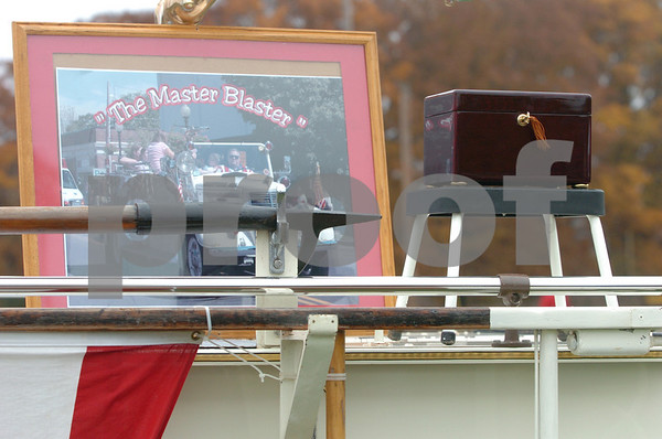 Danvers:<br /> The box containing the remains of Donald Barnett, Jr., along with a photo of him, sit on top of a antique fire truck during his memorial service at Plains Park.<br /> Photo by Ken Yuszkus/Salem News, Friday, November 7, 2008.