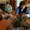 Beverly:<br /> Keri Hinchion, left, and Susan Hall bundle bunches of holly to be sold at the Moraine Farm/Project Adventure.<br /> Photo by Ken Yuszkus/Salem News, Friday, Decmber 4, 2009.
