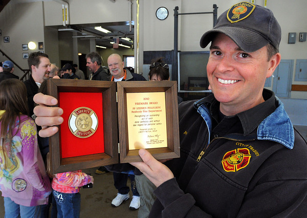 Peabody:<br /> Firefighter Steve Pellegrini received an award and was honored by Liberty Mutual for his heroic act of saving two elderly people who accidentally backed into the Essex River.<br /> Photo by Ken Yuszkus/Salem News, Thursday, February 18, 2010.
