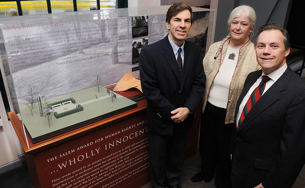Salem:<br /> From left, Brian Watson, Meg Twohey, and Peter LaChapelle, all from the Salem Award committee, stand near the Salem Witch Trials Memorial Exhibition at the National Parks Visitors Center.<br /> Photo by Ken Yuszkus/Salem News, Monday, March 29, 2010.