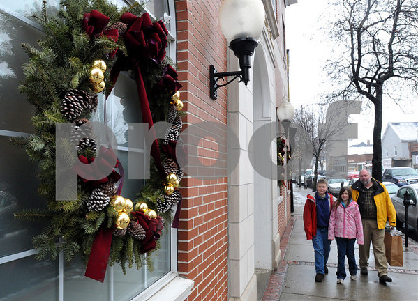 Beverly:<br /> Larry LeGault with his children, John Henry, 12, and Shelly, 10, all from Kingston, New Hampshire, walk near a Christmas wreath on Cabot Steet. School was cancelled in Kingston so Larry decided to bring his children to work and also do some shopping.<br /> Photo by Ken Yuszkus/Salem News, Wednesday December 17, 2008.