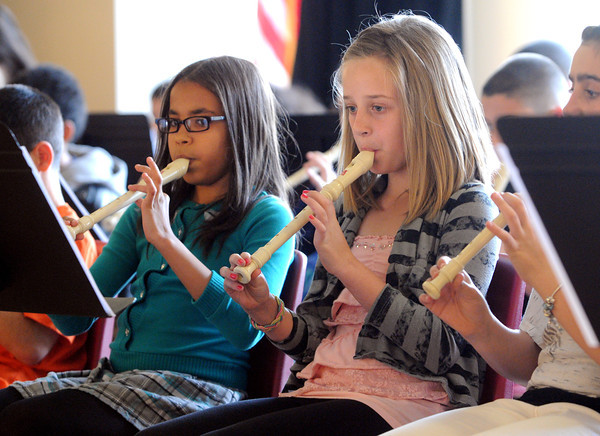 Peabody:<br /> Alayda Santana, left, and Erin Silva play during the recorder concert by the fourth grade at the Brown School Tuesday afternoon.<br /> Photo by Ken Yuszkus/Salem News, Tuesday, May 8, 2012.