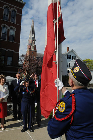 Peabody:<br /> Stephen Godzik, right, raises the Polish flag in front of Peabody City Hall, as Tadeusz Goclawski, post commander, and Constantine Szczechowicz, all from Salem's Polish Legion of American Veterans, Post 55, salute the flag. The Polish flag raising was to remember the Polish constitution originating on May 3, 1791.<br /> Photo by Ken Yuszkus/Salem News, Tuesday, May 3, 2011.