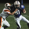 Danvers:<br /> Beverly's Dom Abate, left, takes down Danvers' Jake Cawlina during the Beverly at Danvers football game at Deering Stadium.<br /> Photo by Ken Yuszkus/Salem News, Friday, October 21, 2011.