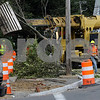 Danvers:<br /> Workers take down a tree on Maple Street at the corner of Hobart Street and Locust Street. The corner is being prepared for installation of traffic lights.<br /> Photo by Ken Yuszkus/Salem News, Monday, August 31, 2009.