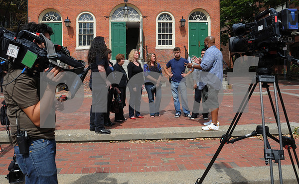 """Salem:<br /> Friends and family of Leanne Marrama are assembled outside the Old Town Hall to be videotaped. Leanne Marrama is the main character in the upcoming episode of """"What Not To Wear"""" appearing on the TLC network.<br /> Photo by Ken Yuszkus/Salem News, Wednesday, September 9, 2009."""
