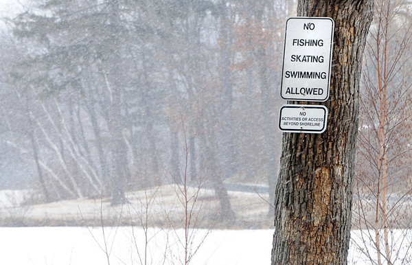 Beverly:<br /> Signs near Cummings Center Pond off McKay Street.<br /> Photo by Ken Yuszkus/Salem News, Tuesday, February 16, 2010.