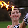 Danvers:<br /> Katie Yeaton, twirls flaming batons for the Danvers High Falcon Band.<br /> Photo by Ken Yuszkus/Salem News,  Tuesday,  November 23, 2010.