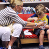 Swampscott:<br /> Rebecca von Barta helps her son John, 3 1/2, with his ice cream sundae during the party to kickoff the Swampscott Public Library's summer reading program.<br /> Photo by Ken Yuszkus/Salem News, Tuesday, June 26, 2012.