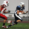 Peabody:<br /> Salem's Alex Veloukas runs after Peabody's Jason Hiou during the Salem at Peabody football game at Coley Lee Field Friday night.<br /> Photo by Ken Yuszkus/Salem News, Friday, September 9, 2011.