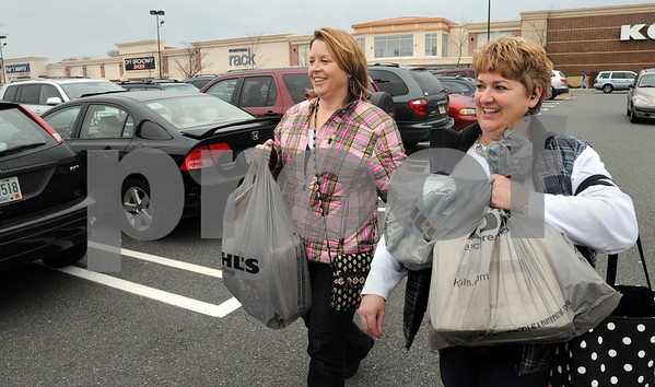 Danvers:<br /> Debbie Petroccione, left, and Marilyn Deschenes, both of Beverly, carry the bargins they purchased in bags, after leaving Kohl's department store. Black Friday sent shoppers swarming the stores looking for bargains.<br /> Photo by Ken Yuszkus/Salem News, Friday November 28, 2008.