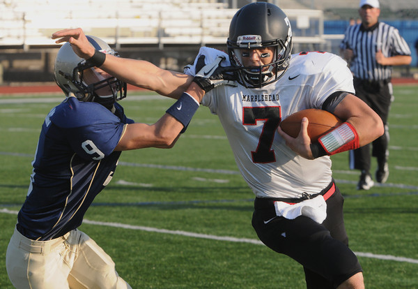 Lynn:<br /> Marblehead's Ian Maag, right, can't shake off a St. Mary's player during the Marblehead football game vs. St. Mary's of Lynn at Manning Field.<br /> Photo by Ken Yuszkus/The Salem News, Friday, September 14, 2012.