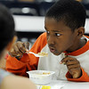 Peabody:<br /> Jacob Hawthorne, 3rd grade, has breakfast at the Welch School on Tuesday morning.<br /> Photo by Ken Yuszkus/Salem News, Tuesday, June 15, 2010.