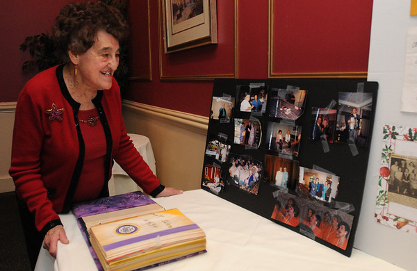 Salem:<br /> Anna Mistretta of Peabody, looks at the display of photos through the years while at the Catholic Daughters of America 90th anniversary luncheon.<br /> Photo by Ken Yuszkus/Salem News, Wednesday, December 16, 2009.