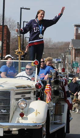 Danvers:<br /> Meghan Duggan, 2010 U.S. women's hockey silver medalist from Danvers, waves to the crowds on Maple Street during the parade in her honor.<br /> Photo by Ken Yuszkus/Salem News, Sunday, March 21, 2010.