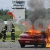 Beverly:<br /> Area firefighters arrive at the Beverly Airport to fight the car fire, which is a simulated plane crash.<br /> Photo by Ken Yuszkus/Salem News, Thursday, June 11, 2009.