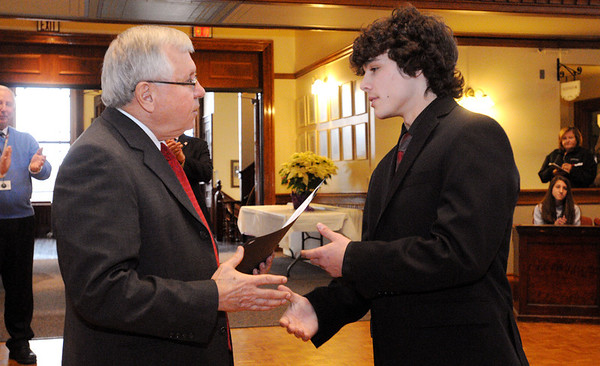 Peabody:<br /> Mayor Bonfanti gives a citation to runner Nick Christensen. Runner Catarina Rocha received one too. Also, he honored the state champion girls soccer team and gave out citations to them at Peabody City Hall Thursday morning.<br /> Photo by Ken Yuszkus/Salem News, Thursday, December 15, 2011.