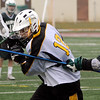 Peabody:<br /> Troy Reinold carries the ball despite being battered by an Austin Prep player at the Austin Prep at Bishop Fenwick boys lacrosse game.<br /> Photo by Ken Yuszkus/Salem News, Monday, April 4, 2011.