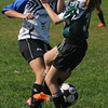 Peabody:<br /> Peabody's Chloe Gizzi, left, fights for the ball during the Peabody vs Lynn U14 game during the Peabody Youth Soccer's annual Columbus Day Tournament at Kennedy School fields.<br /> Photo by Ken Yuszkus/Salem News, Monday, October 10, 2011.