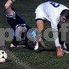 Danvers:<br /> Andrew Goldstone of Peabody is upended as he collides with Chris Ciampa of Danvers, who gets a chance to reach the ball at the Peabody vs Danvers boys soccer game at Danvers High School.<br /> Photo by Ken Yuszkus/Salem News, Tuesday September 23, 2008.