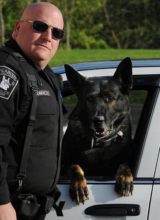 Peabody:<br /> Officer Eric Zawacki with Argo at the police station. Argo helped apprehend a car thief.<br /> Photo by Ken Yuszkus/Salem News, Friday, April 30, 2010.