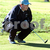 Beverly:<br /> Peter Sucharewicz of Peabody lines up his putt on the 18th hole at the Beverly Golf & Tennis Club during the Division 1 State golf sectionals.<br /> Photo by Ken Yuszkus/Salem News, Monday October 26, 2009.