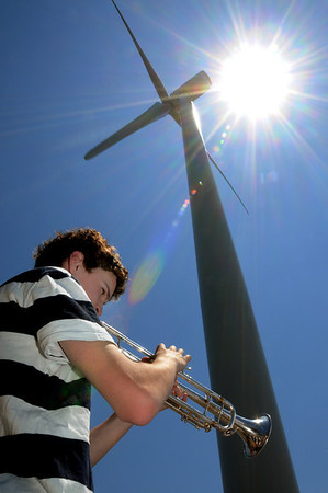 Ipswich:<br /> Conor Fitzpatrick, who along with a few members of the Ipswich High School band, played an opening song to start the ribbon cutting ceremony in front of the new wind turbine.<br /> Photo by Ken Yuszkus/Salem News, Tuesday, June 7, 2011.