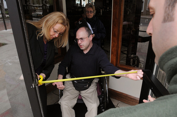 Salem:<br /> From left, Lisa Rose of the Independent Living Center, and Jim Nowlan measure the front door opening of the Adriatic Restaurant, as Annie Fothergill of the Independent Living Center, and Niko Kurti, dining manager of the Adriatic Restaurant, watch the proceedure.<br /> Photo by Ken Yuszkus/Salem News, Tuesday, May 10, 2011.
