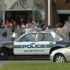 Beverly:<br /> Students exit Beverly High School at the delayed dismissal time of 3 pm at the end of the lockdown of the school. There were 22 caliber long rifle bullets found in the school that prompted the decision to lockdown the school.<br /> Photo by Ken Yuszkus/Salem News, Wednesday, October 29, 2008.