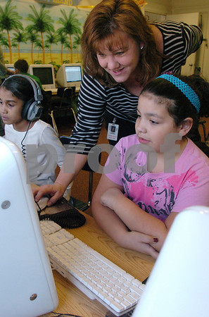 Salem:<br /> Shania Torres, third grader, receives some help on a computer program called Study Island which helps kids gear up for the MCAS test. from Judy Borden, teacher at Horace Mann Laboratory School. J. J. Moore is the student on the left.<br /> Photo by Ken Yuszkus/Salem News, Tuesday, March 17, 2009.