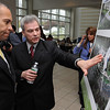 Danvers:<br /> Gov. Deval Patrick listens to Peter Fourtounis of the architectual firm, DiMella Shaffer, talk about the solar panels planned for the Allied Health building at North Shore Community College which is pictured in the artist renderings. The governor had just finished speaking about ARRA funding and a solar panel project for the Berry Building.<br /> Photo by Ken Yuszkus/Salem News, Thursday, February 25, 2010.