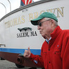 Salem:<br /> Thomas G. Brown, Jr., right, of Gloucester, donated his 34' Webber Cove power boat to Sail Salem. He is standing near his newly named boat at Dion Yatch Yard.<br /> Photo by Ken Yuszkus/Salem News, Tuesday, August 16, 2011.