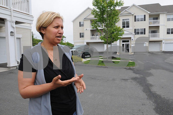 Peabody:<br /> Yvette Preira talks about last year's fire at Highlands at Dearborn and how it affected her and her family at the time of the fire and afterwards.<br /> Photo by Ken Yuszkus/Salem News, Thursday May 28, 2009.
