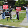 Hamilton:<br /> From left, George LaMontagne, William Dery, candidate, Linda Saunders, and Terry Hubbard who is standing for her son, candidate Jeff Hubbard, wave to voters as they drive into the driveway of the Winthrop School Thursday afternoon.<br /> Photo by Ken Yuszkus/Salem News, Thursday, May 26, 2011.