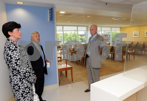 Peabody:<br /> From left, Mary Bellavance, Peabody mayor's assistant, and Michael Bonfanti, Peabody mayor, listen to Shawn Kinney, director of site operations, describe the new wing at Lahey Clinic, North Shore while leading a tour. Lahey Clinic, North Shore, unveiled its newly constructed 65,000 square foot, outpatient wing and clinical services expansion during a ribbon-cutting ceremony and site tour.<br /> Photo by Ken Yuszkus/Salem News,  Wednesday, June 3, 2009.