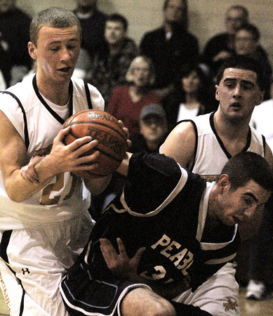 Peabody:<br /> Bishop Fenwick's Ben Maxner, left, and Peabody's Mike Gould grab at the ball after it comes off the basket during missed shot at the Peabody at Bishop Fenwick boys basketball game.<br /> Photo by Ken Yuszkus/Salem News, Tuesday, December 27, 2011.