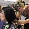 Salem:<br /> Ann Marie Lavoie, teacher, left, gets her cut by Lindsey Catterson at the Witchcraft Heights Elementary School. About 20 children and adults are donating a minimum of 8 inches of hair to be sent to Pantenes Beautiful lengths who makes wigs for people with cancer. Many hairdressors are volunteering their services to cut and style hair in the art room at the school.<br /> Photo by Ken Yuszkus/Salem News, Monday, June 20, 2011.