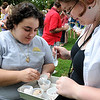Salem:<br /> Kathleen Cancelino, left, and her friend, Colleen Shea, share a tray of different samples of ice cream. The public had a chance to sample flavors from many of the North Shore's creameries, ice cream shops and restaurants. The event was part of Heritage Days.<br /> Photo by Ken Yuszkus/Salem News, Monday, August 8, 2011.