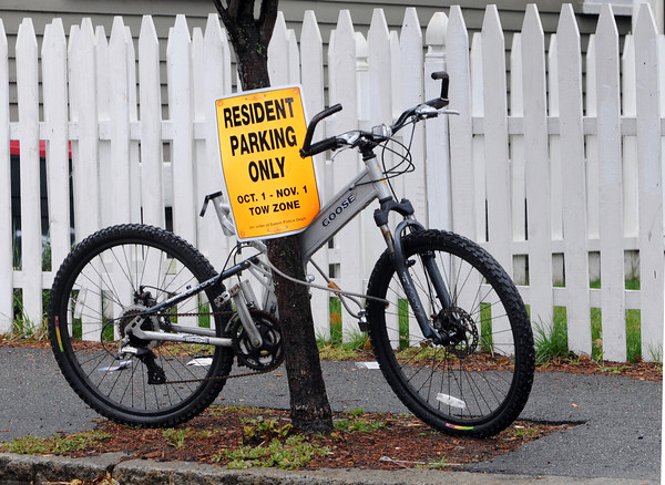 """Salem:<br /> The """"resident parking only"""" sign must apply to bicycles as well. This bicycle was parked on Essex Street.<br /> Photo by Ken Yuszkus/Salem News, Tuesday October 13, 2009."""