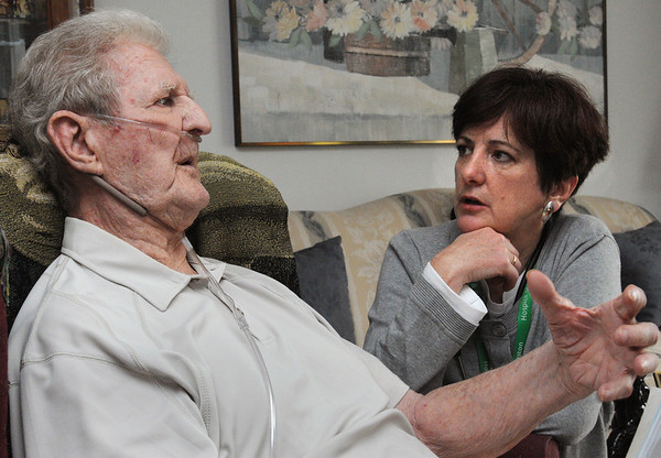 "Danvers:<br /> Edward Flynn speaks with Dr. Louise DePodesta about his illness while at his home. Dr. Louise DePodesta, a doctor at Hospice of the North Shore & Greater Boston, will meet with veterans as part of the Freedom Rock Project, a program that assists military veterans who are patients at Hospice of the North Shore. As part of the program, DePodesta, herself a veteran, has designed an engraved rock with the words, ""Freedom, in gratitude for your service to our country,"" to be given to every patient who is a veteran.<br /> Photo by Ken Yuszkus/Salem News, Wednesday, May 25, 2011."