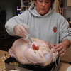 Beverly:<br /> Lyn Ego bastes the turkey before placing it in the oven early Thanksgiving morning before she goes to the Salem at Beverly football game at Hurd Stadium to see her son Alex Ego play.<br /> Photo by Ken Yuszkus/Salem News, Thursday, November 25, 2010.