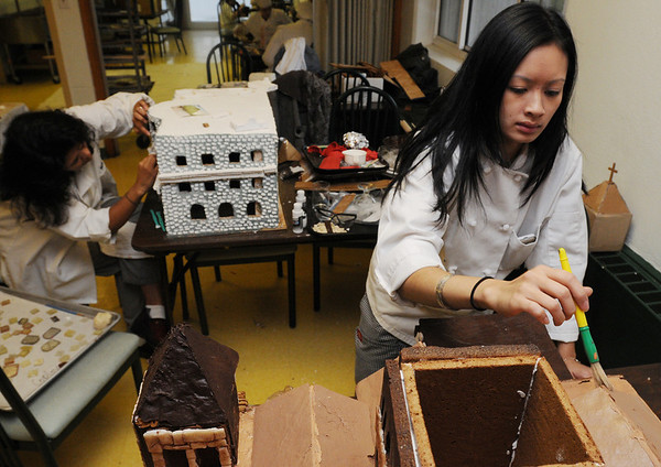 Danvers:<br /> Sabina Petersen, left, adds transparent candy windows to a model of the Copley Plaza Hotel as Dung Kim Nguyen adds coloring to the ouside of a model of Trinity Church. NSCC culinary students are preparing a giant Copley Square for display in Boston.<br /> Photo by Ken Yuszkus/Salem News, Monday November 30, 2009.