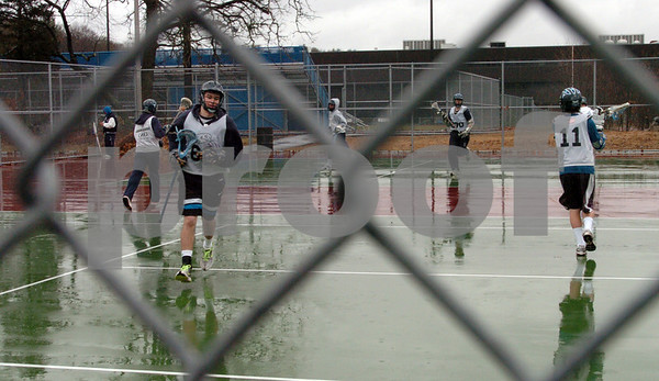 Peabody:<br /> Because of the rain, the Peabody boys lacrosse team practiced on the tennis courts at the high school. <br /> Photo by Ken Yuszkus/Salem News, Monday, March 30, 2009.