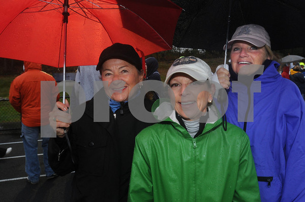 Danvers:<br /> From left, Nancy Marino, Lynda Salvanelli, and Pat Freni were part of the crowd of walkers preparing to start on their 3-mile walk in the rain during the  22nd Annual Walk for Hospice from Cronin Memorial Stadium at St. John's Prep.<br /> Photo by Ken Yuszkus/Salem News, Sunday October 18, 2009.