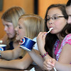Danvers:<br /> From left, Amanda Warren, Emma Quigley, Nora Chan, and Lauren Hyde eat ice cream Monday afternoon. They were part of the Highlands Elementary School performing ensembles that were treated to an ice cream social at the school.<br /> Photo by Ken Yuszkus/Salem News, Monday, June 27, 2011.