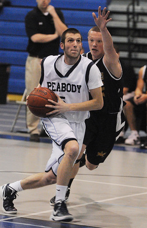 Peabody:<br /> Peabody's Jason Hiou looks for the net with Bishop Fenwick's Dom Luoni at his side during the Bishop Fenwick at Peabody boys basketball.<br /> Photo by Ken Yuszkus/Salem News, Monday, January 23, 2012.